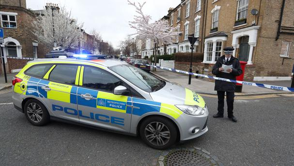 Police seal off Wilberforce Road, near Finsbury Park, in north London