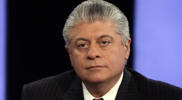 Andrew Napolitano has been taken off the air by Fox News Channel following his claim that British intelligence had helped former president Barack Obama spy on Donald Trump (AP)