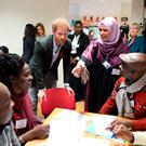 Prince Harry speaks with staff and volunteers on a training course at the Leicestershire Aids Support Service (LASS) in Leicester