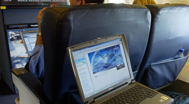 File photo dated 29/07/2002 of a laptop being used on a plane as airline passengers are to be banned from carrying laptops in cabin luggage on inbound direct flights from Turkey, Lebanon, Jordan, Egypt, Tunisia and Saudi Arabia, Downing Street said.