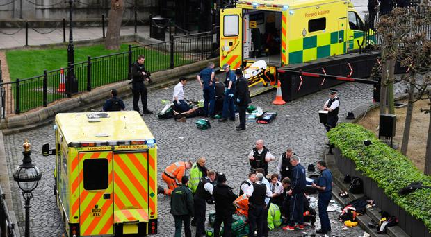 Emergency services attend a man