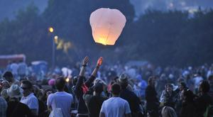 Revellers light and let go of sky lanterns, but campaigners urge councils to ban them on their land