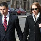 Pilot Paul Brady Grebenc, 35, arrives with his wife Emily, at Paisley Sheriff Court. Grebenc, a US citizen, has admitted preparing to fly a United Airlines flight from Glasgow to Newark, New Jersey, while more than twice the legal alcohol limit