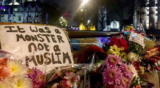 A pointed message among floral tributes left after the vigil in Trafalgar Square for attack victims