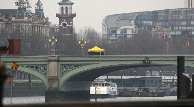 A forensics tent on Westminster Bridge after the attack in which a man hit pedestrians with a car before stabbing a police officer to death
