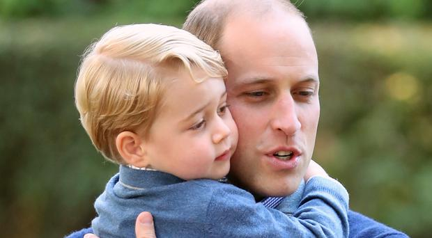 The Duke of Cambridge with Prince George