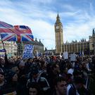 Between 25,000 and 100,000 campaigners stood with their heads bowed for a minute-long silence with the only sound the chiming of Big Ben