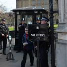 Armed police at Carriage Gates, one of the entry points to the Palace of Westminster in central London
