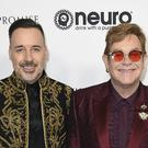 Sir Elton John and David Furnish arrive at the celebration in Los Angeles (AP)