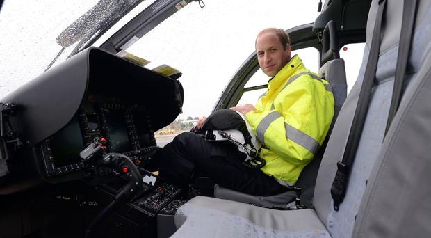 The Duke of Cambridge in an East Anglian Air Ambulance helicopter