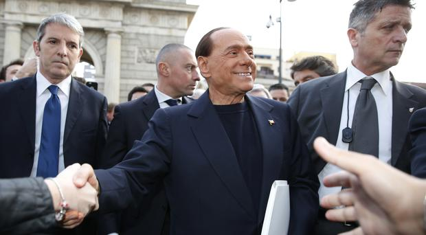 Berlusconi rose to power with his Forza Italia party (AP)