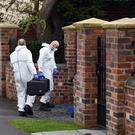 Police activity near the scene in Stourbridge where a 13-year-old boy and his mother have died after being stabbed