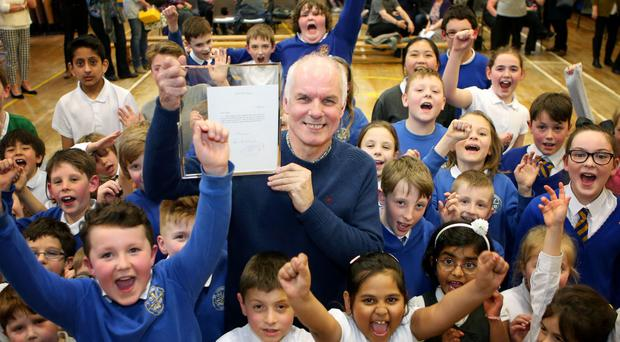 Andy Cairns holds a signed letter from Sir Paul McCartney after pupils at St Cuthbert's Primary School in Edinburgh wrote to The Beatles star