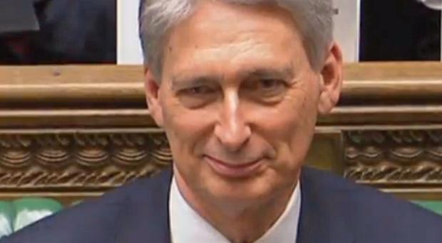 Philip Hammond's promise of an extra £2 billion for social care over the next three years did not go far enough, MPs said