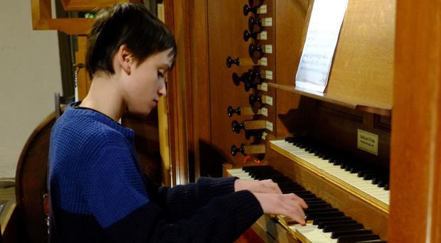 Louis Moss, who has become the youngest person to play the organ for an Oxford University college (Helen Moss/Family Handout/PA)