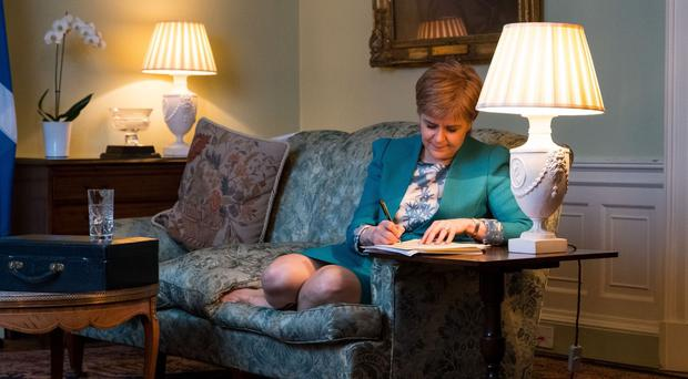 First Minister Nicola Sturgeon writes the letter to Theresa May (Scottish Government)