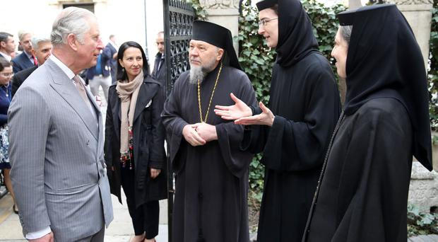 The Prince of Wales meets religious leaders during a walking tour of the Old Town in Bucharest