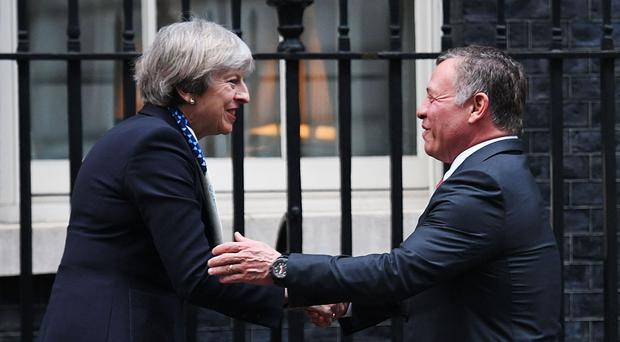 Theresa May greeting King Abdullah II of Jordan when he visited London