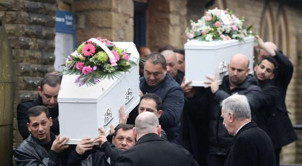 The coffins of hit-and-run victims Helina Kotlarova, 12, and her cousin, Zaneta Krokova, 11, at their funeral in Oldham