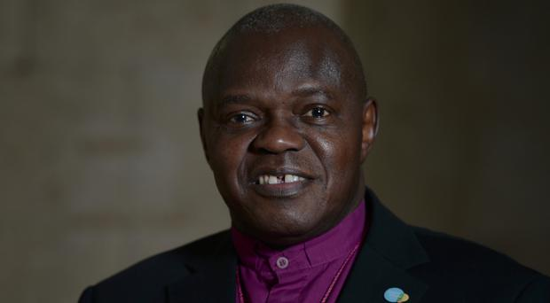 Archbishop of York Dr John Sentamu has attacked Cadbury and the National Trust for removing the Easter reference in the egg hunt logo