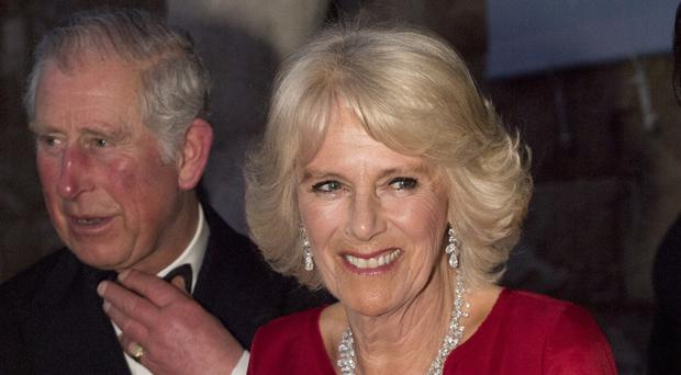 The Prince of Wales and the Duchess of Cornwall at a gala dinner at the Palazzo Vecchio in Florence