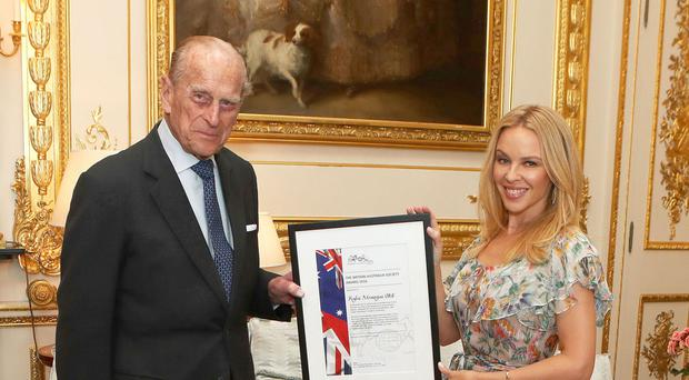 The Duke of Edinburgh presents Kylie Minogue with the Britain-Australia Society Award for 2016