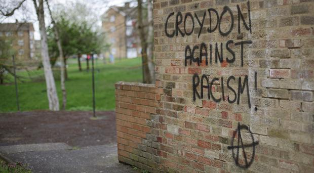 Graffiti reading 'Croydon against racism' near the scene where teenage asylum seeker Reker Ahmed was brutally attacked