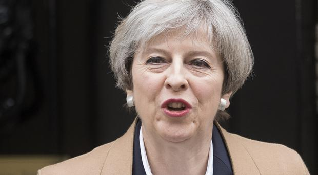 Prime Minister Theresa May has vowed to keep up pressure on internet giants such as Google over extremist content
