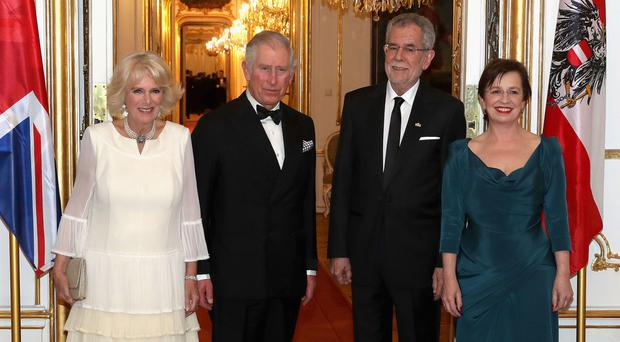 Charles and Camilla are greeted by Austria's prresident Alexander Van der Bellen and first lady Doris Schmidauer at Hofburg Palace