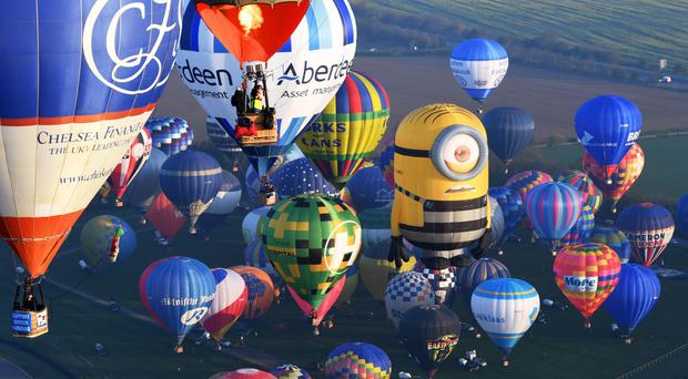 Some of the 100 balloons taking part in the world record attempt