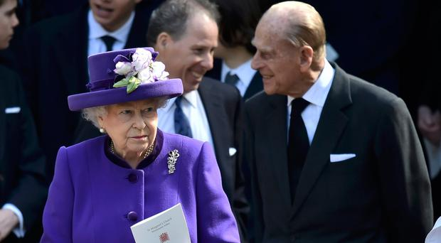 The Queen and Duke of Edinburgh leave the service for Lord Snowdon