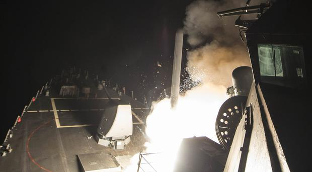 USS Ross firing a tomahawk land attack missile from the Mediterranean Sea (US Dept of Defense)