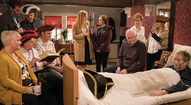Emmerdale character Ashley Thomas with his family and friends at his bedside (ITV)