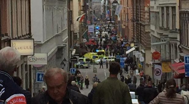 Emergency services at the scene of the lorry attack in Drottninggatan, a street in the centre of Stockholm (Lasse Gare/PA)
