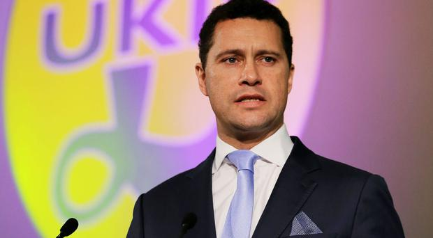 Steven Woolfe, a former Ukip MEP, says in the report that applicants would be assessed on their education, qualifications and suitability for work