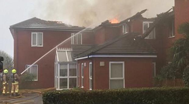 Handout photo taken with permission from the Twitter feed of @hemelwhitefire of Hertfordshire Fire Service at the scene of a fire at Newgrange residential care home