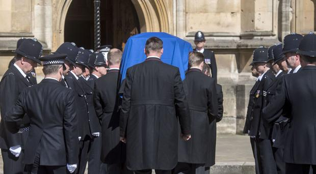 The coffin of Pc Keith Palmer passes a police guard of honour as it arrives at Westminster's Chapel of St Mary Undercroft