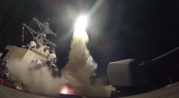 Undated handout photo issued by the US Navy of USS Porter (DDG 78) firing a tomahawk land attack missile from the Mediterranean Sea, as Britain backed the US missile strike on a Syrian air base as an 'appropriate response' to Bashar Assad regime's 'barbaric' chemical attack.