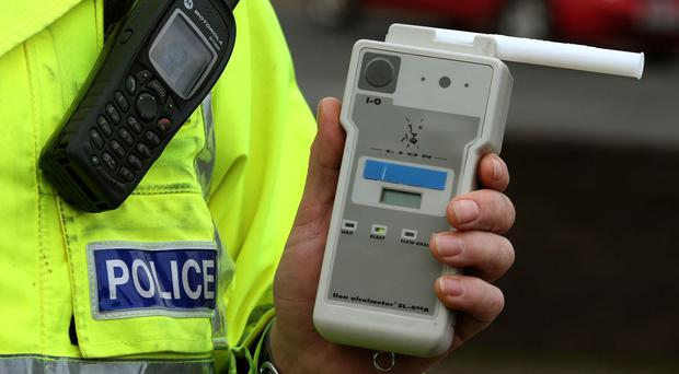 A mother was more than three times over the drink-drive limit when she lost control of her car on the way to a wake