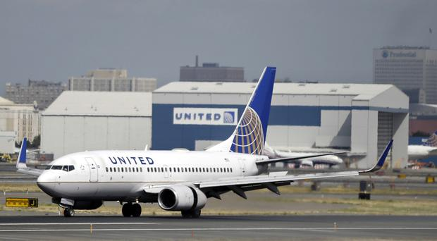 A United Airlines passenger was forcibly removed from an overbooked flight from Chicago to Louisville (AP)