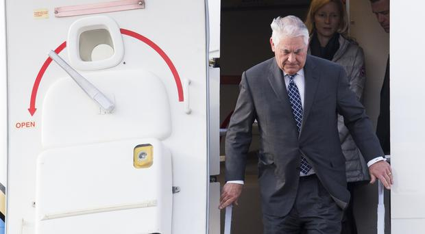 Rex Tillerson steps out of a plane upon arrival in Moscow's Vnukovo airport before crucial talks with Sergey Lavrov (AP Photo/ Ivan Sekretarev)