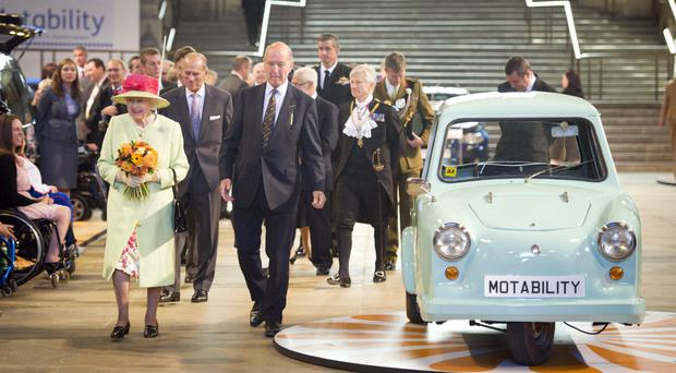 The Queen and the Duke of Edinburgh at an event to mark the three millionth Motability vehicle in 2012