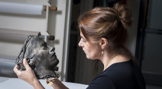 Tracey Emin with her portrait Death Mask at the Conservation Studio (National Portrait Gallery/PA)