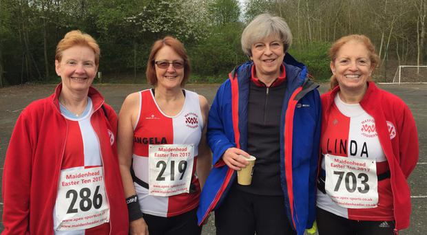 Theresa May with some of the runners at the Maidenhead 10-mile race (@LindaMcQuaid1/Twitter/PA)