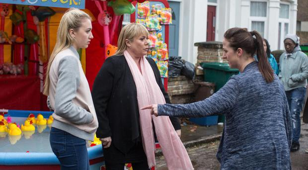 Louise Mitchell (played by Tilly Keeper), Sharon Mitchell (Letitia Dean) and Sonia Fowler (Natalie Cassidy) in EastEnders (BBC/PA)