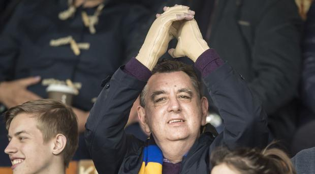 Double hand transplant patient Chris King applauds as the teams appear on the pitch at Headingley Carnegie stadium in Leeds