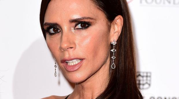 Victoria Beckham wears posh frock to accept OBE from Prince William