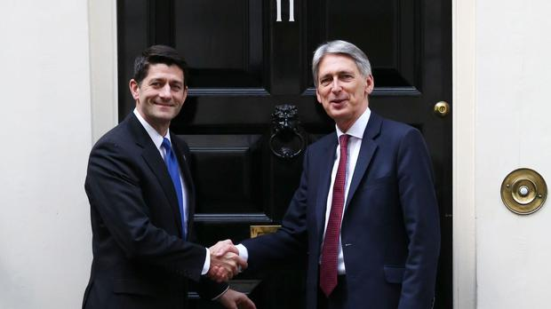 Chancellor Philip Hammond greets US Speaker of the House of Representatives Paul Ryan as he arrives for talks at 11 Downing Street