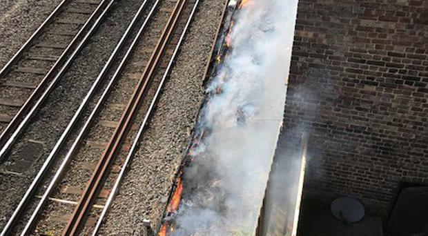 A fire next to rail tracks near South Hampstead in London (Network Rail/PA)