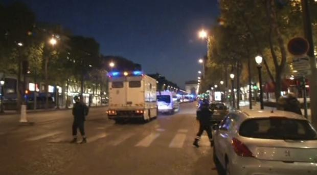 Police at the scene on the Champs-Elysees in Paris (AP Photo)